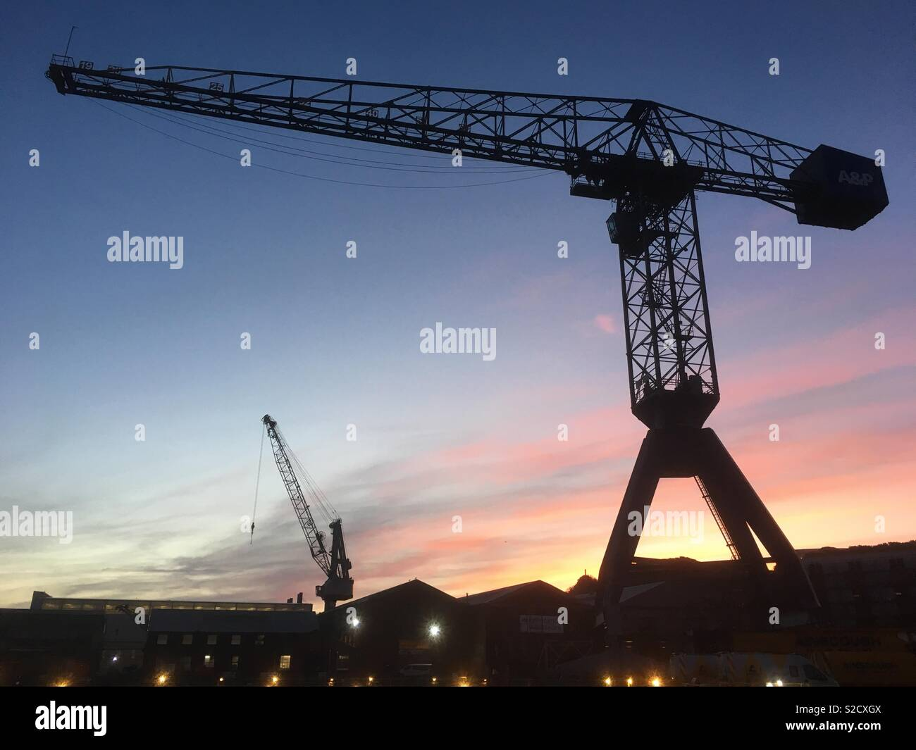 Cranes waking up for work. - Stock Image