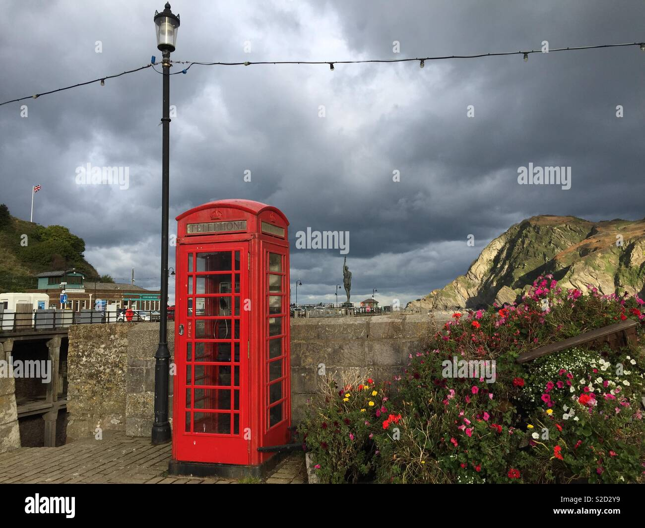 Hillsborough from Ilfracombe harbour with the statue by Damien Hurst of Verity in the distance - Stock Image