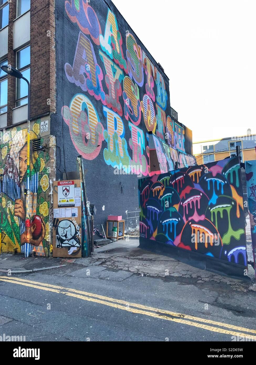 Shoreditch street art graffiti on rivington street, London - Stock Image