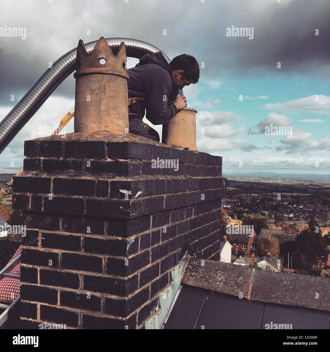 Fitting a chimney liner - Stock Image