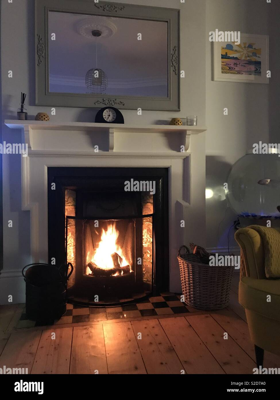 Winter evening in front of fire - Stock Image