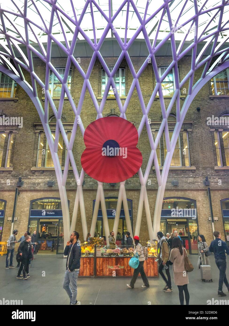 Remembrance Day poppy installation for the armistice centenary in kings cross st Pancras train station, london, england, britain - Stock Image