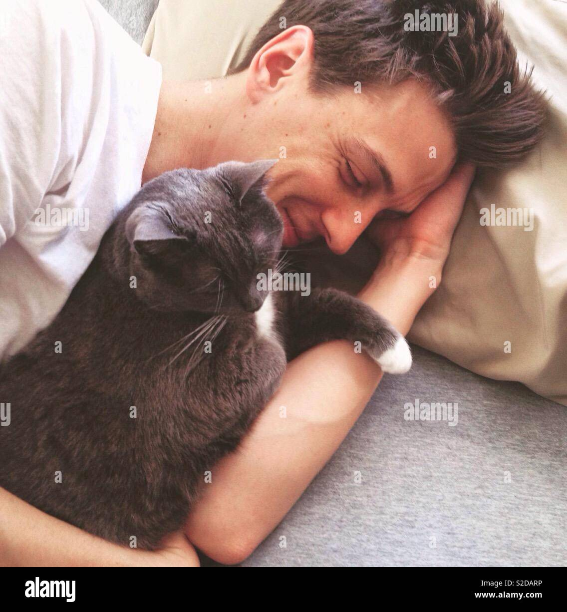 Man and cat, man with cat, cute cat - Stock Image