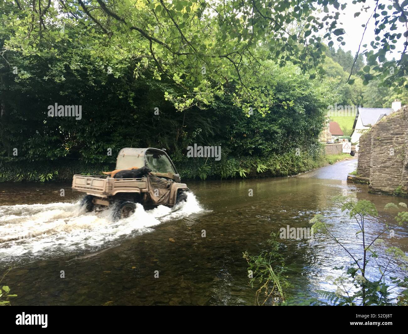 Fording a river, Exmoor - Stock Image
