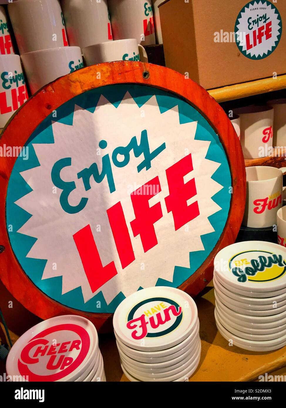 Enjoy life sign at a retail store, USA - Stock Image