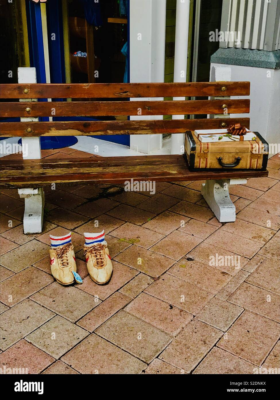 Bubba Gump Bench Suitcase And Running Shoes Stock Photo Alamy
