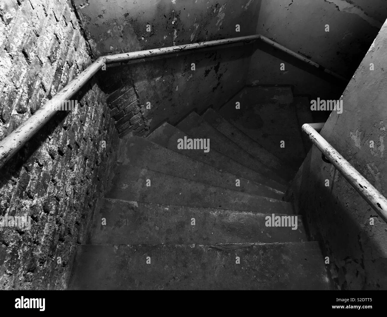 Stairs to the basement of an old building. - Stock Image
