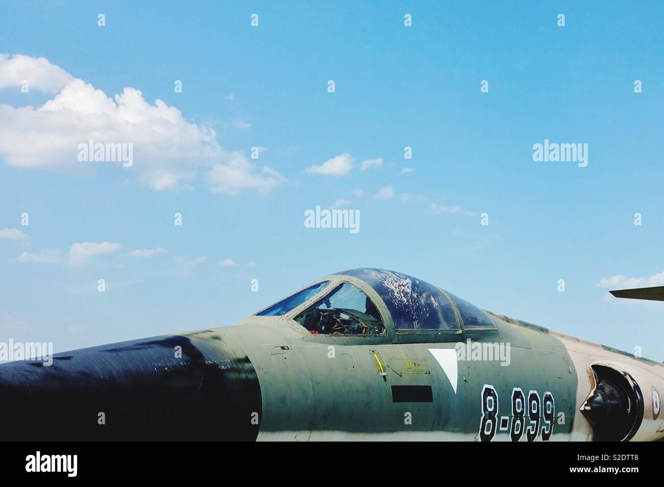Old Russian fighter jet. Cockpit in front of clear sky - Stock Image