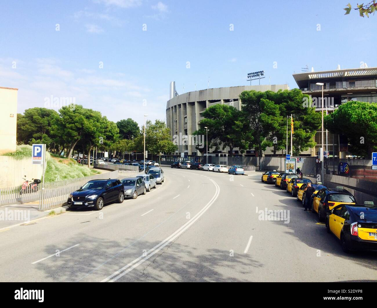 Taxis and cars parked in the street at the Camp Nou football stadium in Barcelona Spain - Stock Image
