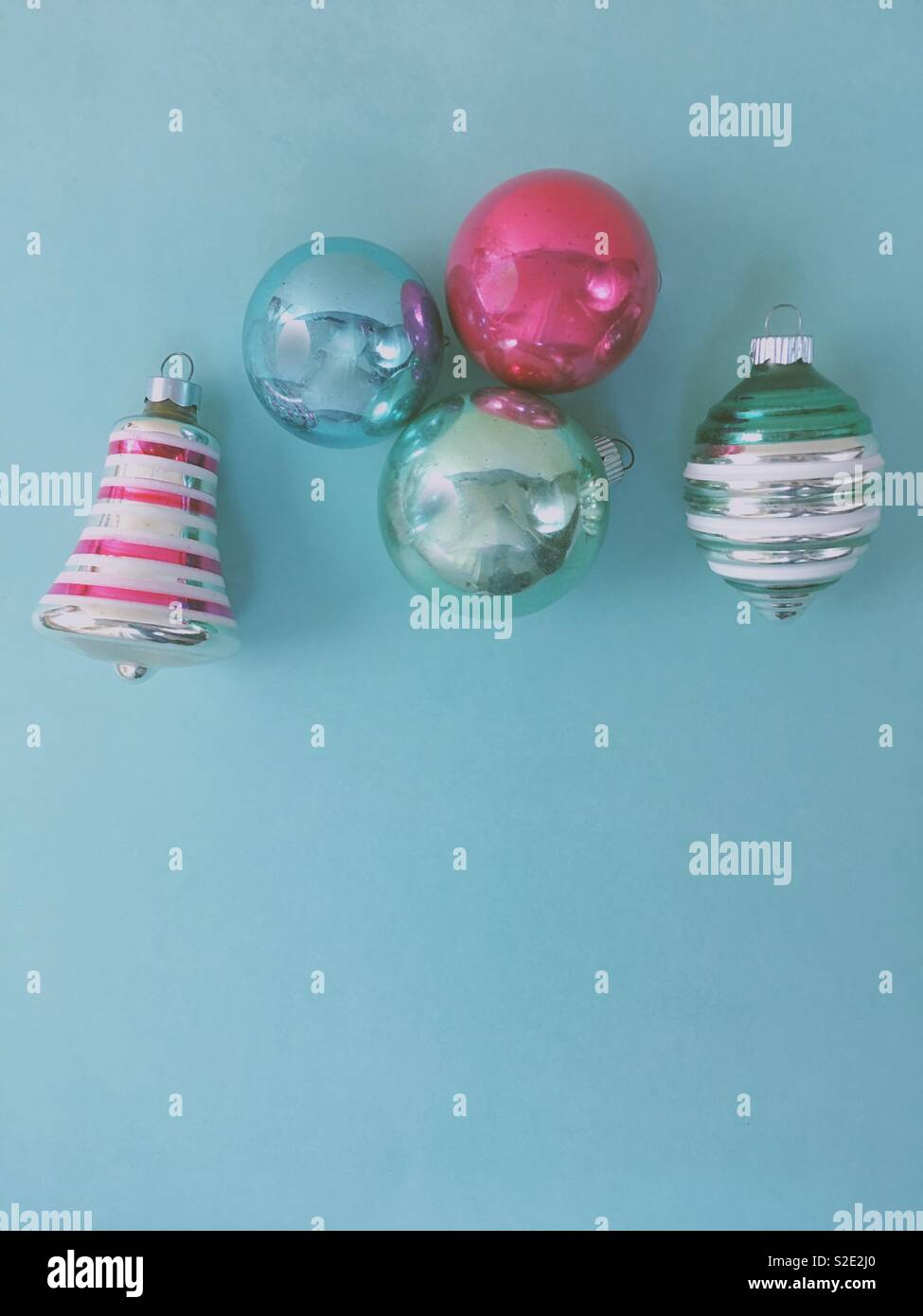 Vintage Christmas Ornaments In Pastel Colors On A Light Blue