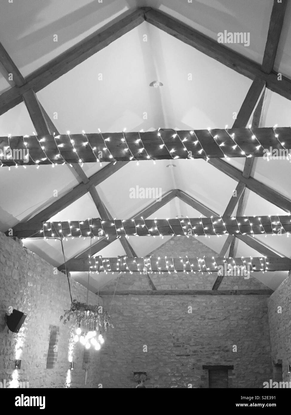 Image of: A Vaulted Ceiling In A British Farm House With Fairy Lights Across The Wooden Beams In Monochrome Stock Photo Alamy