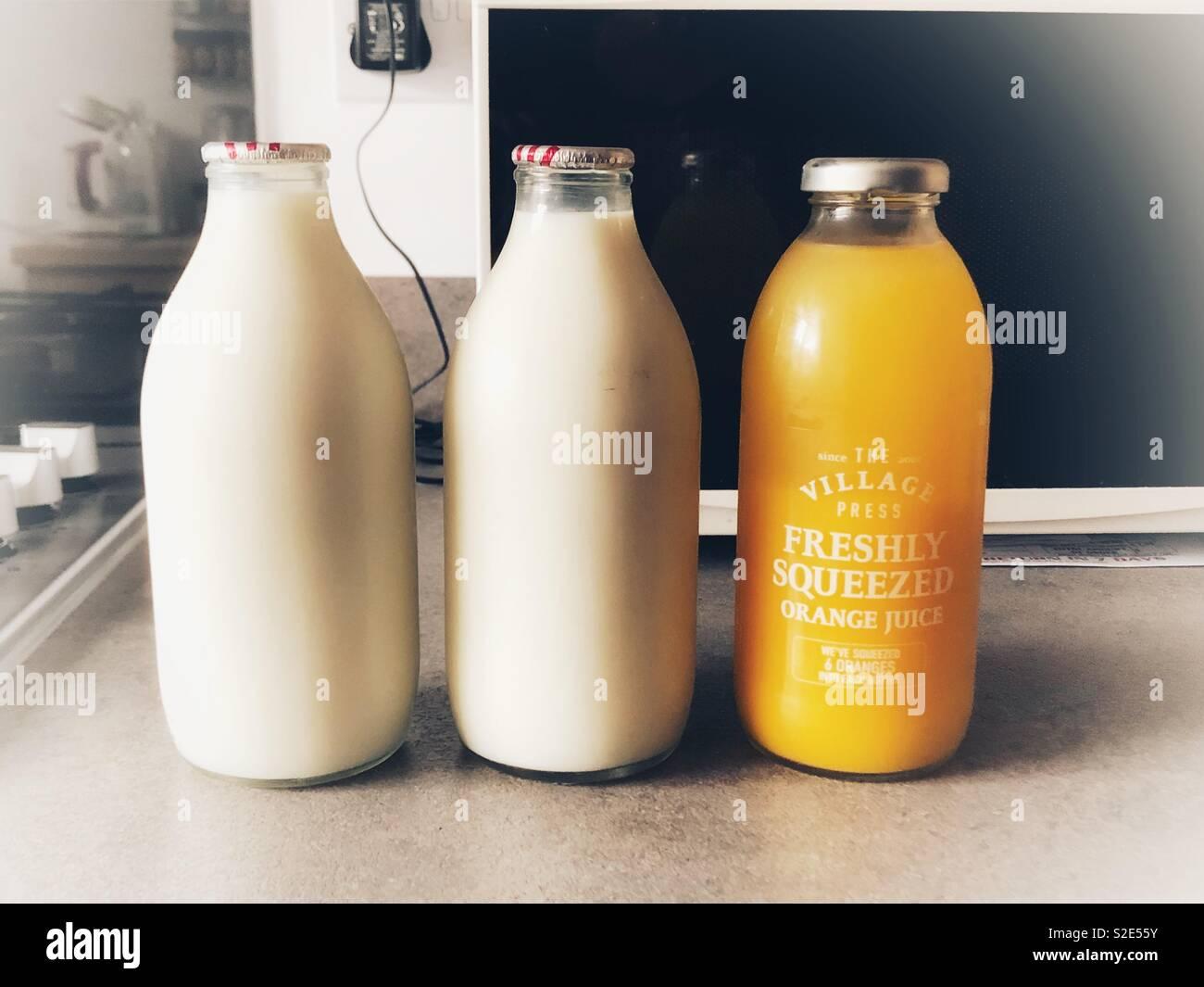 Milk And Orange Juice Stock Photo Alamy