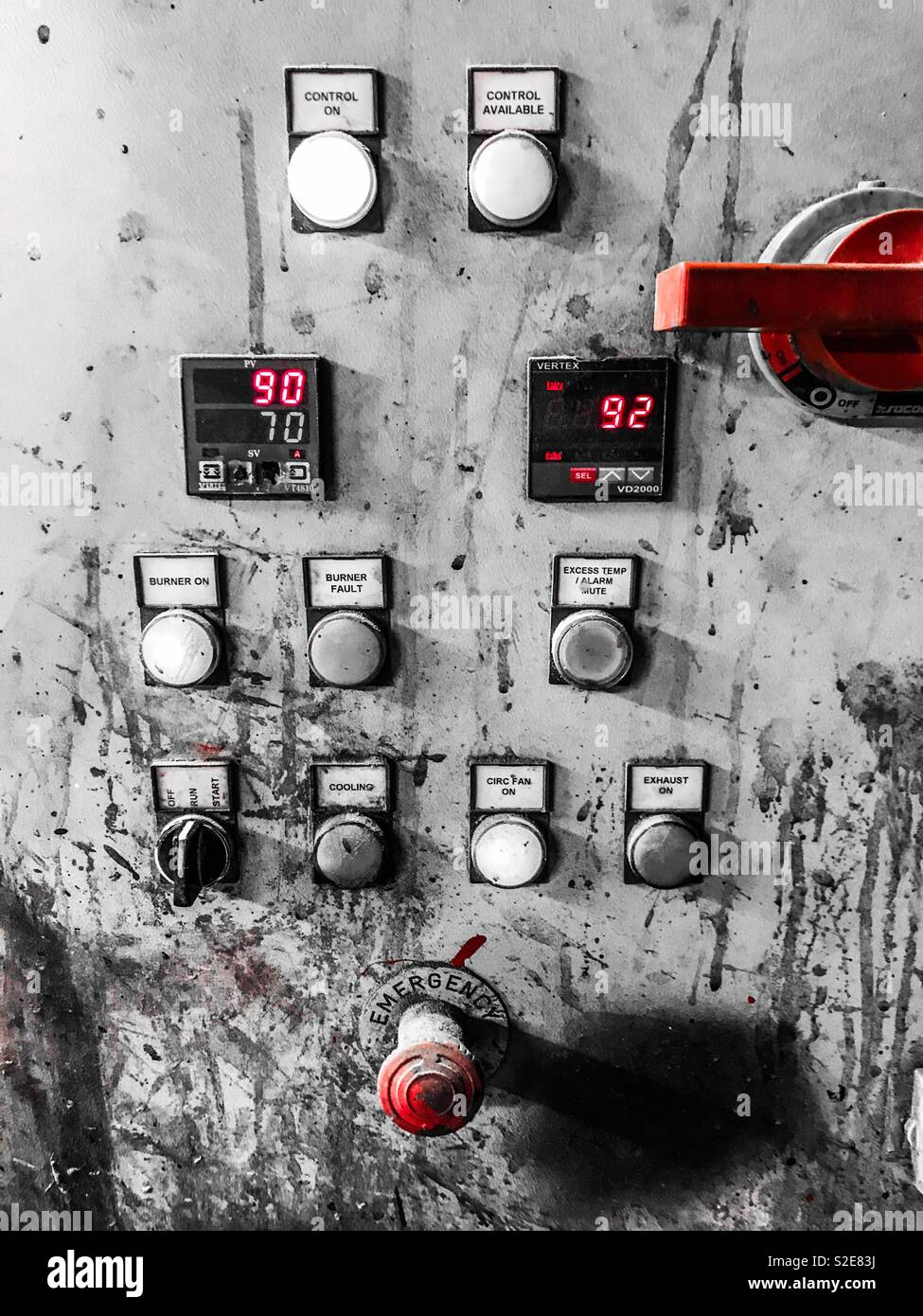 Industrial oven control panel showing temperature settings with selective colour - Stock Image