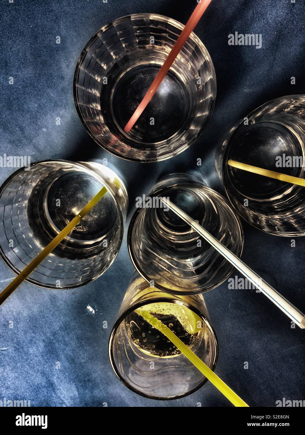 View of glasses with drinks and straws from the top Stock Photo