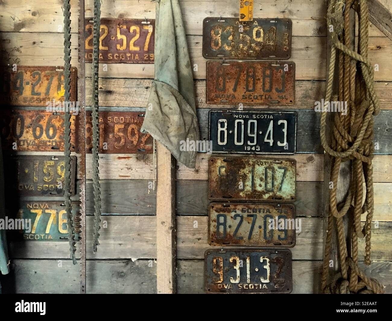 Old number plates of Nova Scotia Canada in an old wooden shed - Stock Image