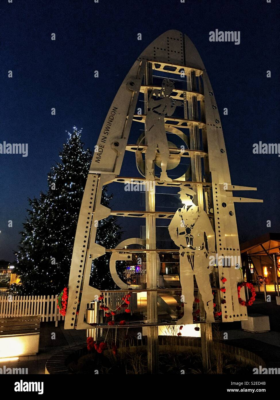 Swindon monument with poppies and Christmas tree - Stock Image