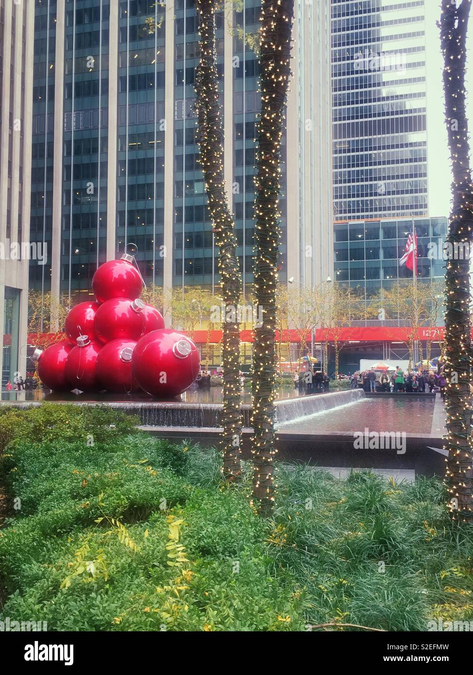 Giant Christmas tree ornament display on Avenue of the Americas during the holiday season, New York City, United States Stock Photo