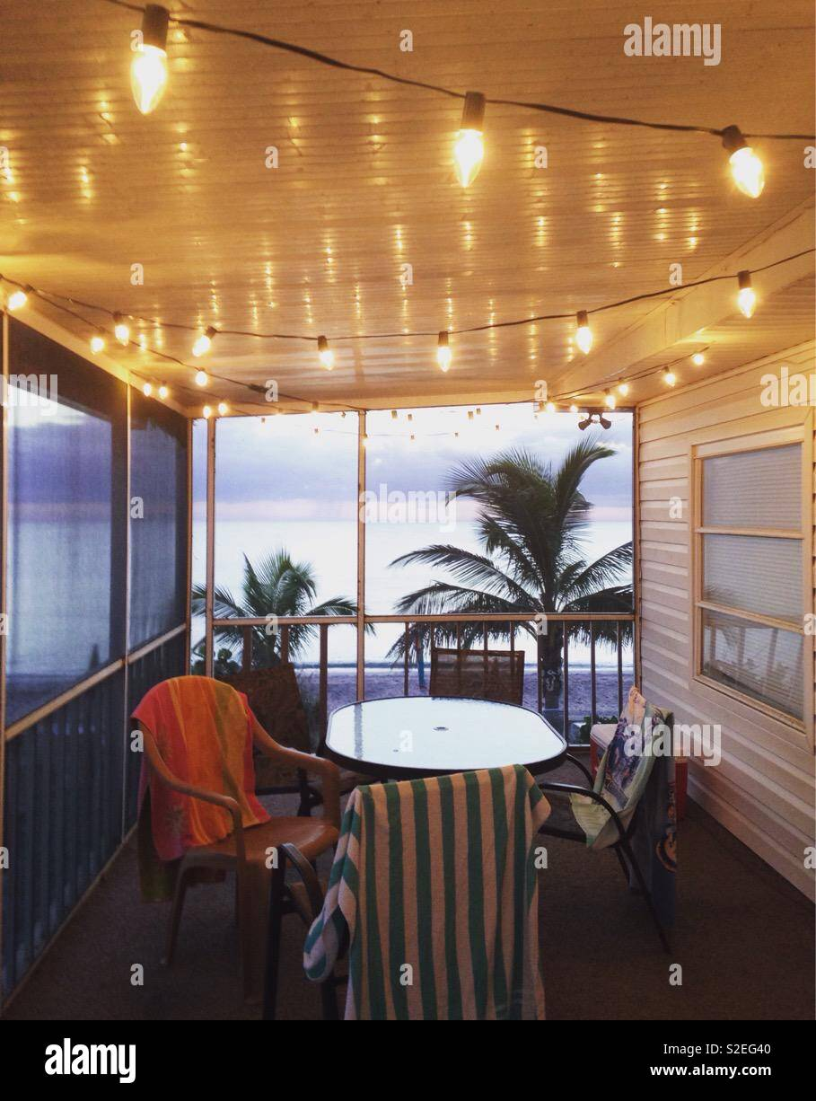 String lights decorate a cozy beachfront patio on a vacation home in Florida Stock Photo