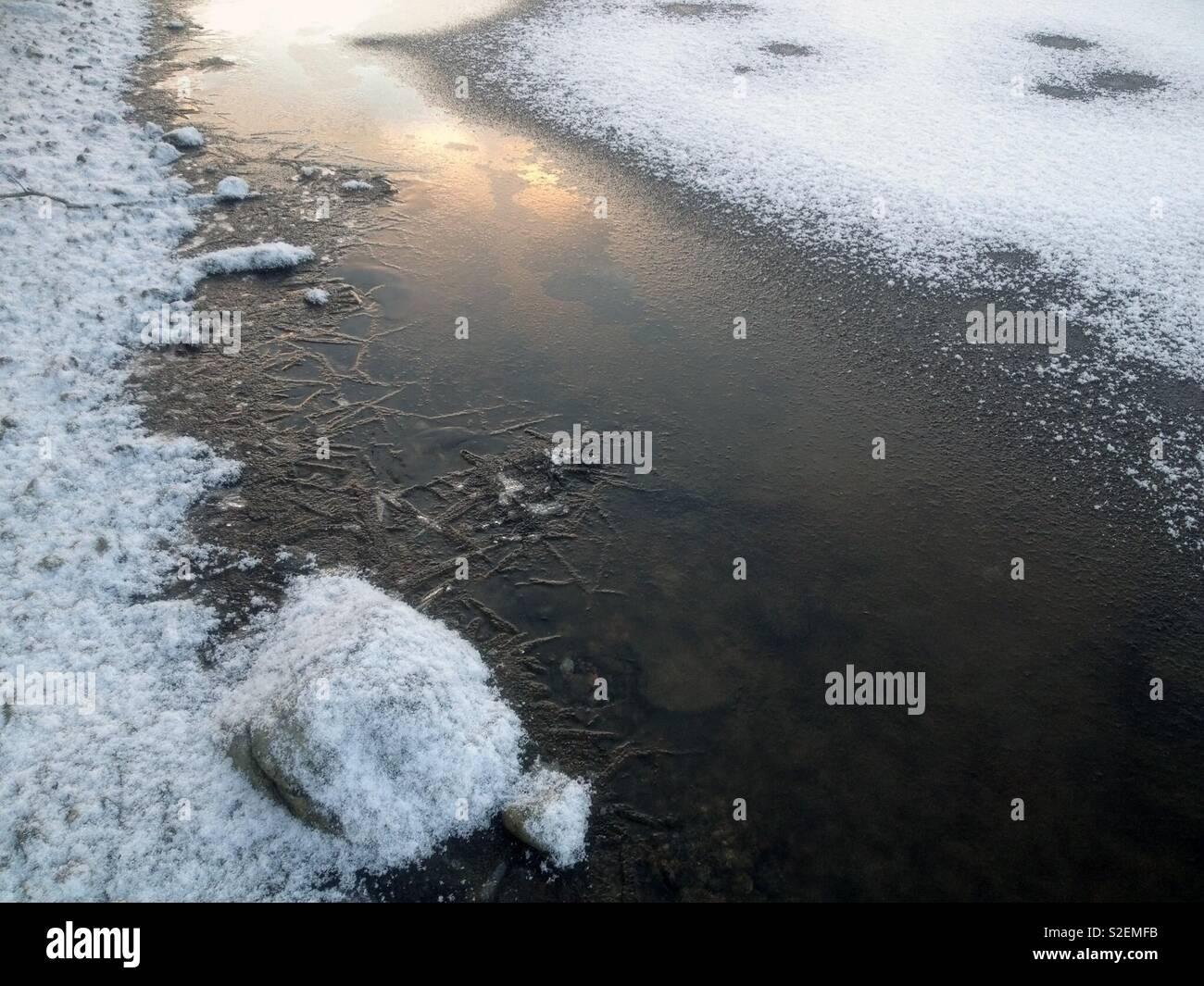 Lake freezing over, Lappeenranta Finland - Stock Image