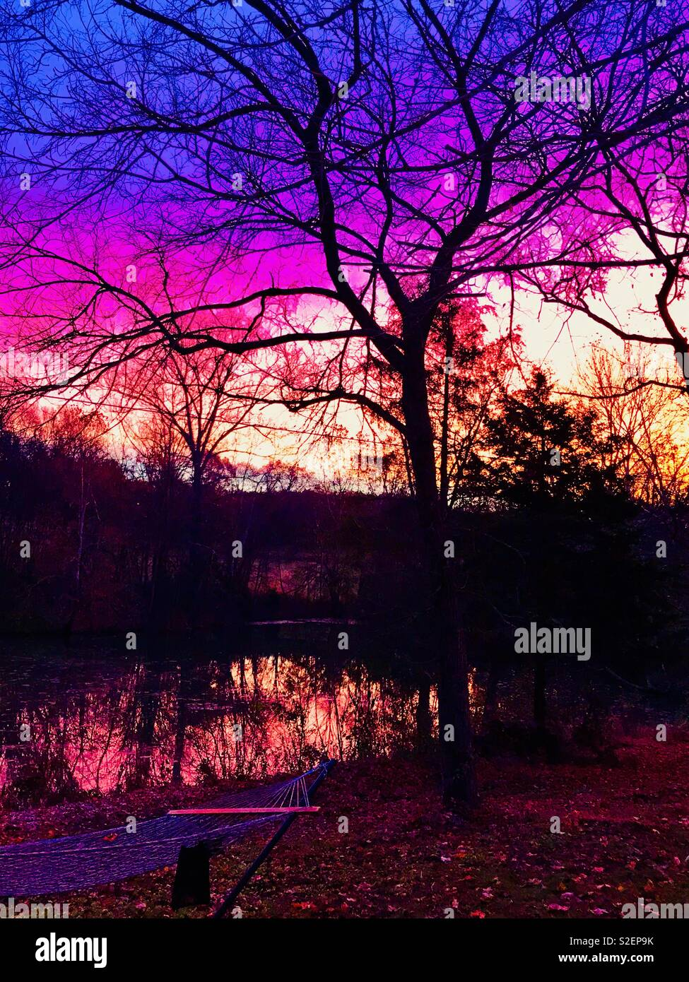 Sunset coloring a country sky Stock Photo: 311340783 - Alamy