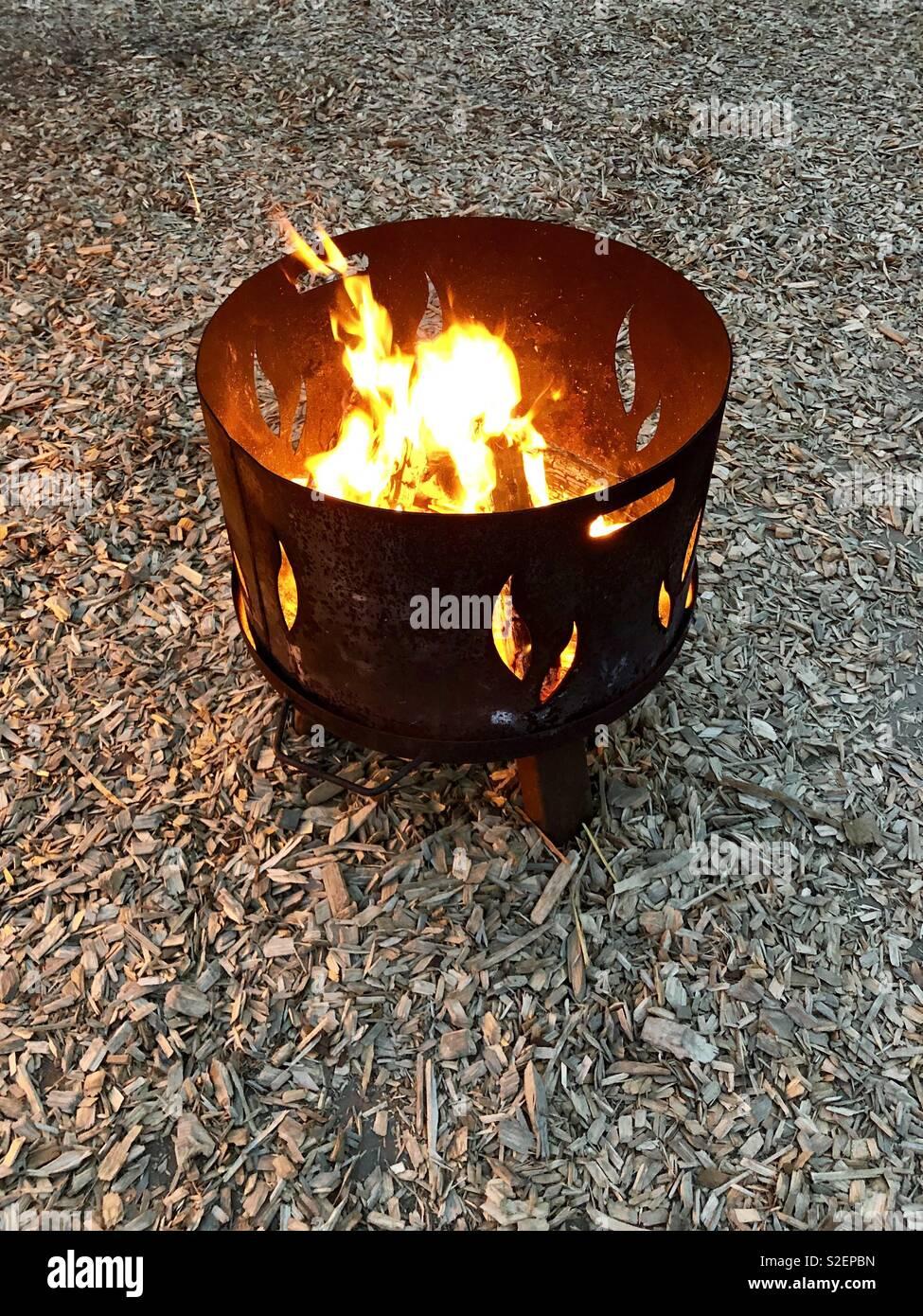 Blazing fire in a handmade fire pit. - Blazing Fire In A Handmade Fire Pit Stock Photo: 311340841 - Alamy