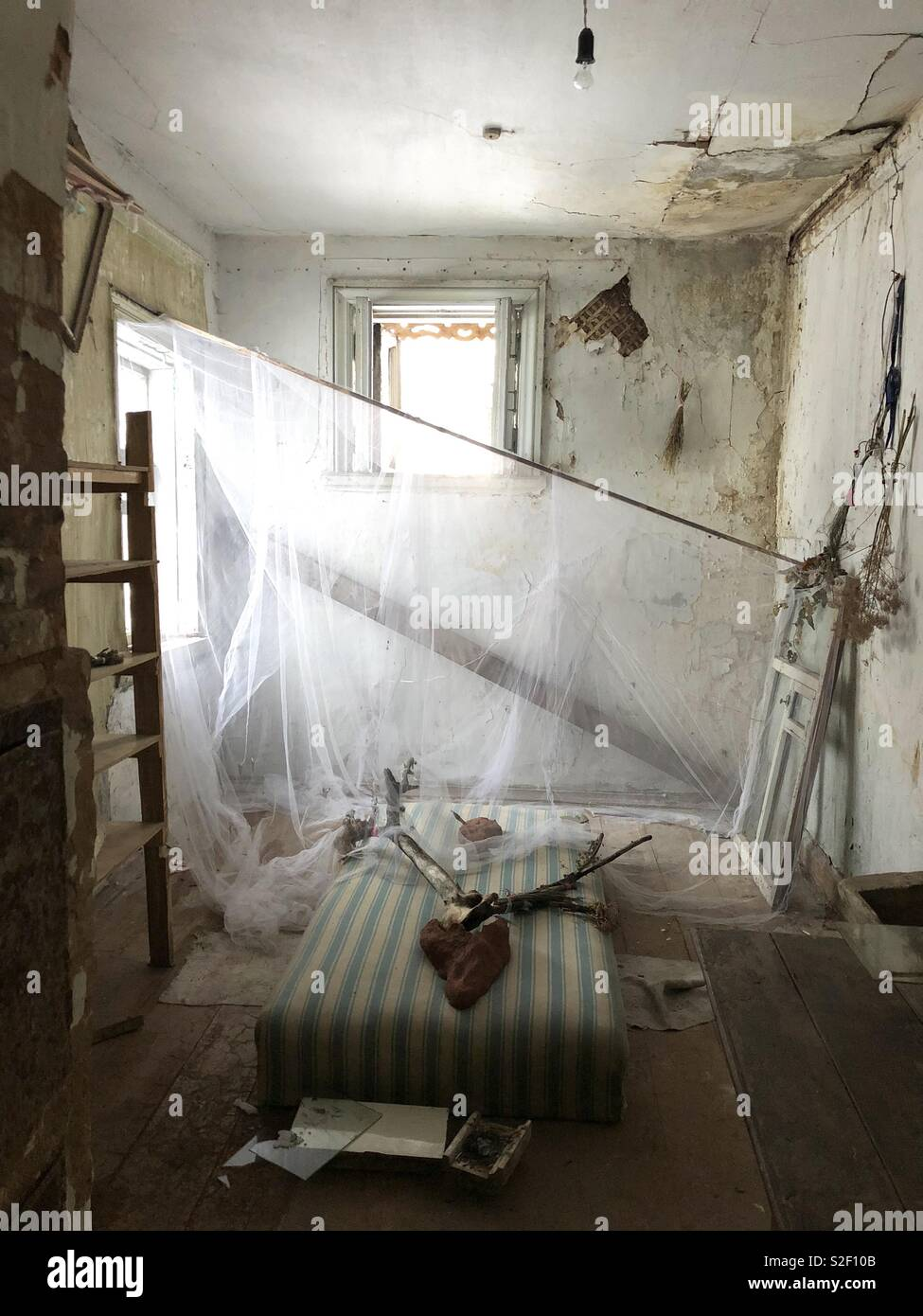 Creepy art installation in a dilapidated historical building Stock Photo