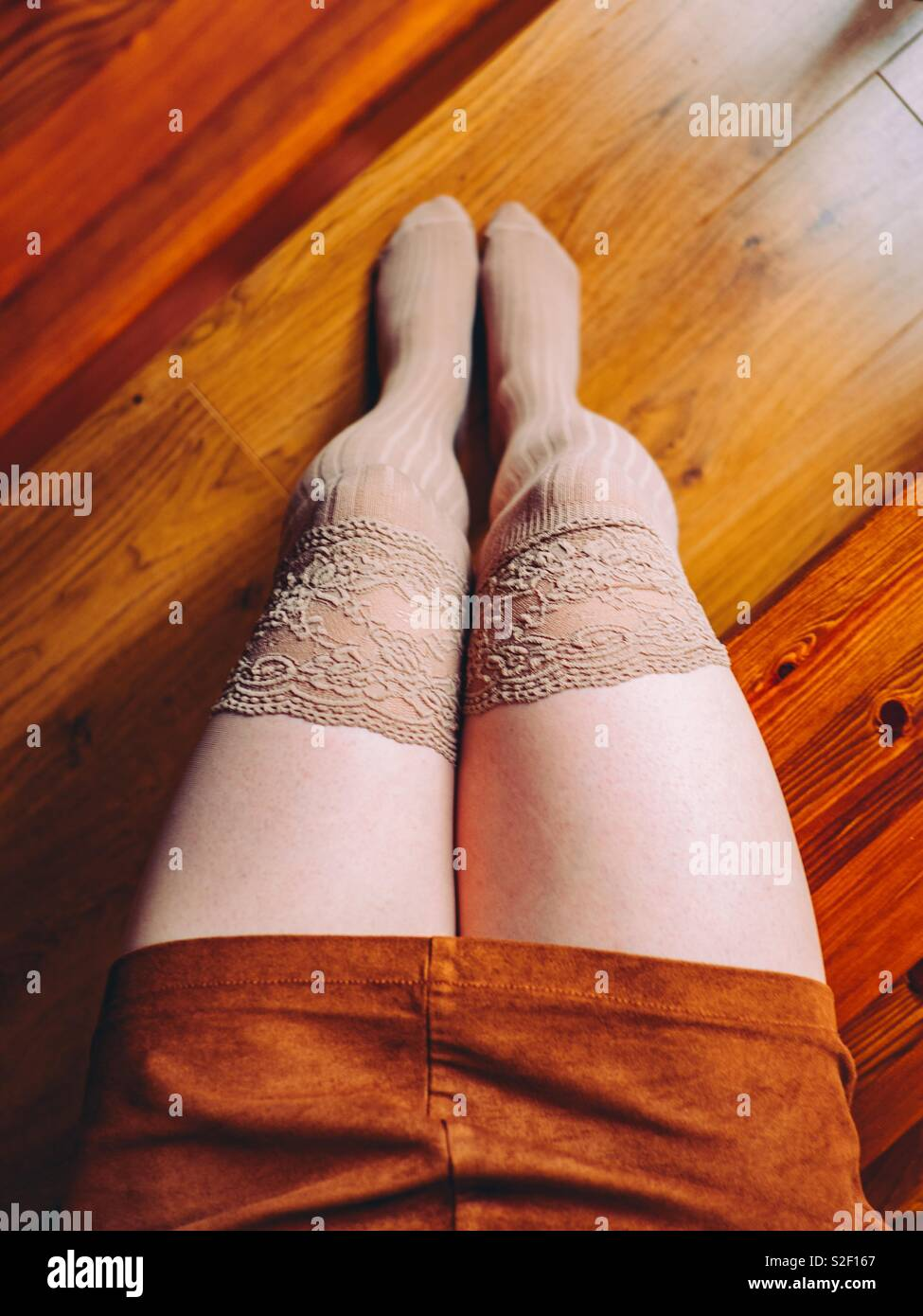 Woman wearing over the knee socks Stock Photo