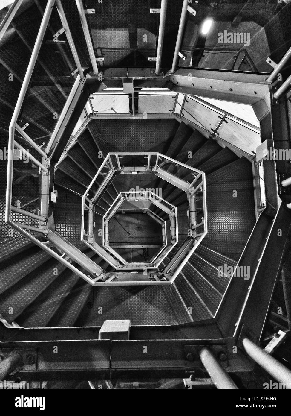 View of spiral stairs from the top of a chapel tower - Stock Image