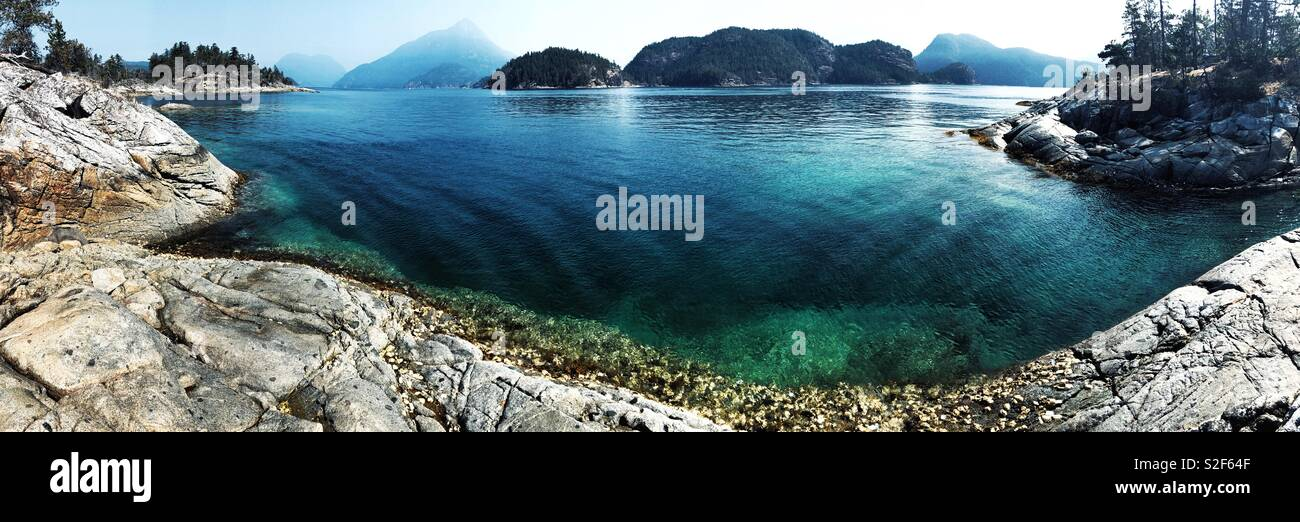 Pristine turquoise waters of Desolation Sound off the coast of Vancouver Island, BC, Canada - Stock Image