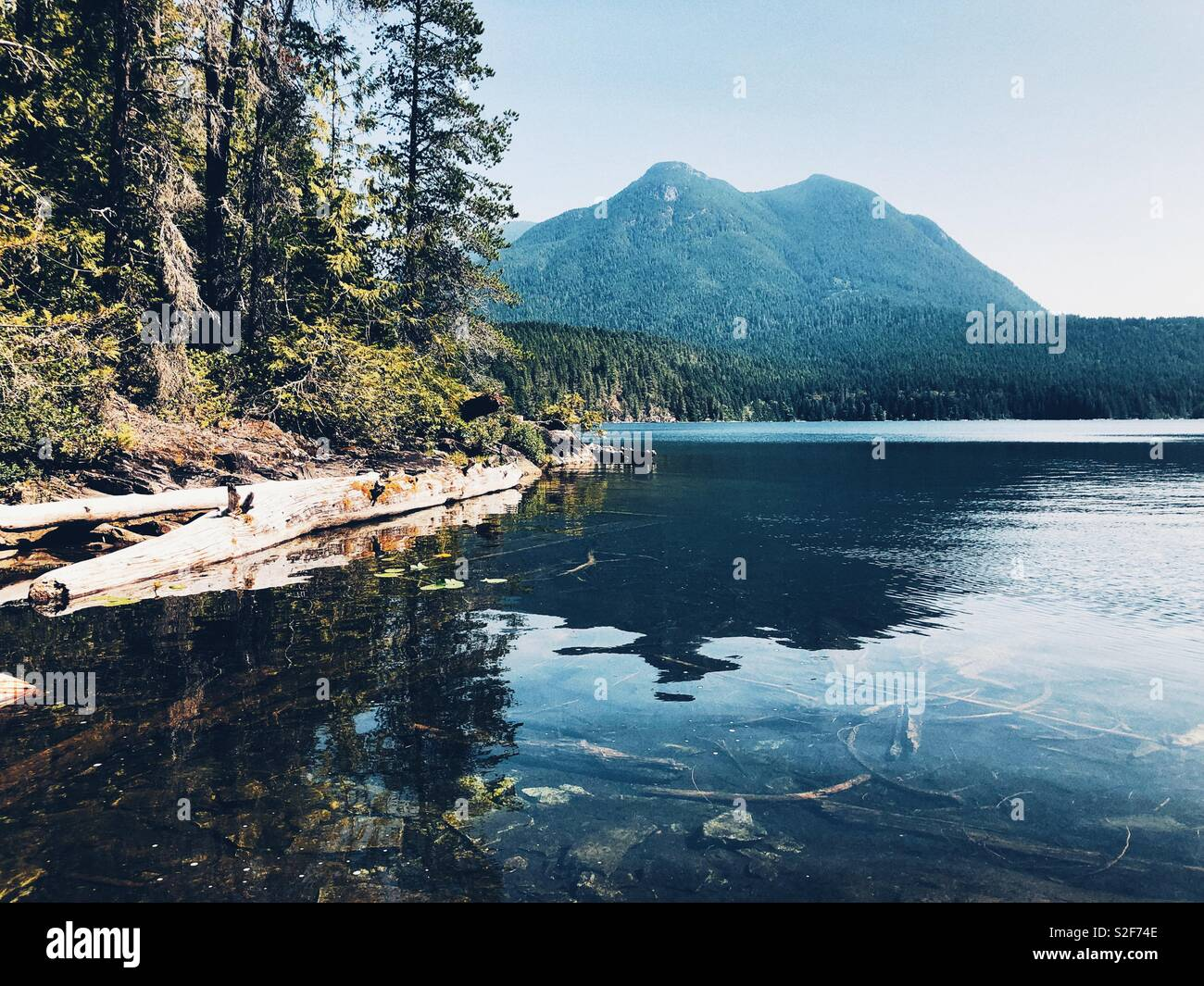 Clear fresh water of Unwin Lake in Desolation Sound Marine Provincial Park, BC, Canada - Stock Image