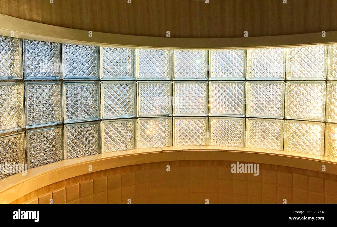 Textured glass panels backlit by sunlight - Stock Image