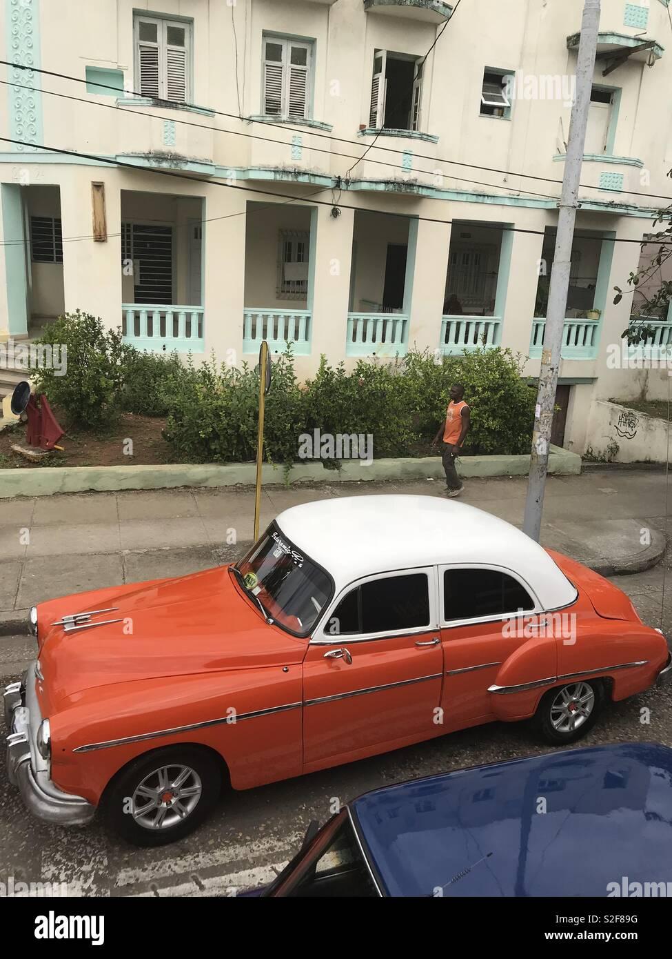 Outstanding orange and white classic car in Havana Cuba - Stock Image