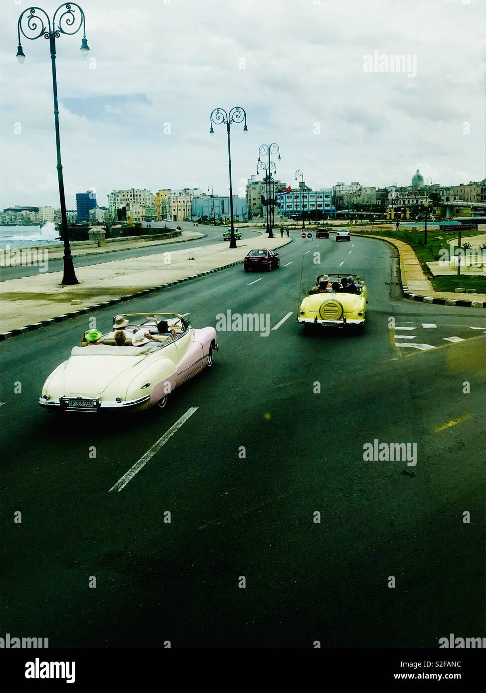 Classic cars cruising down the streets of Havana Cuba - Stock Image