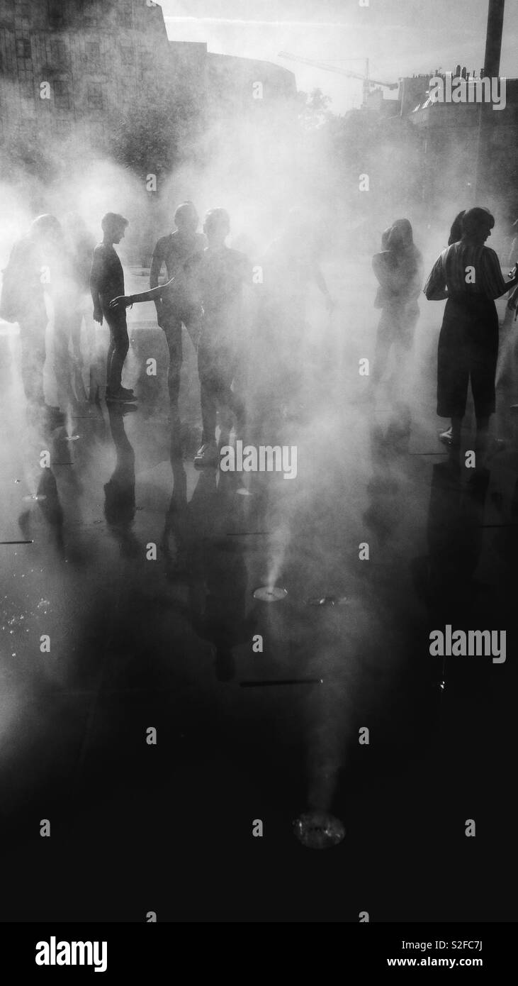 People in a fog - Stock Image