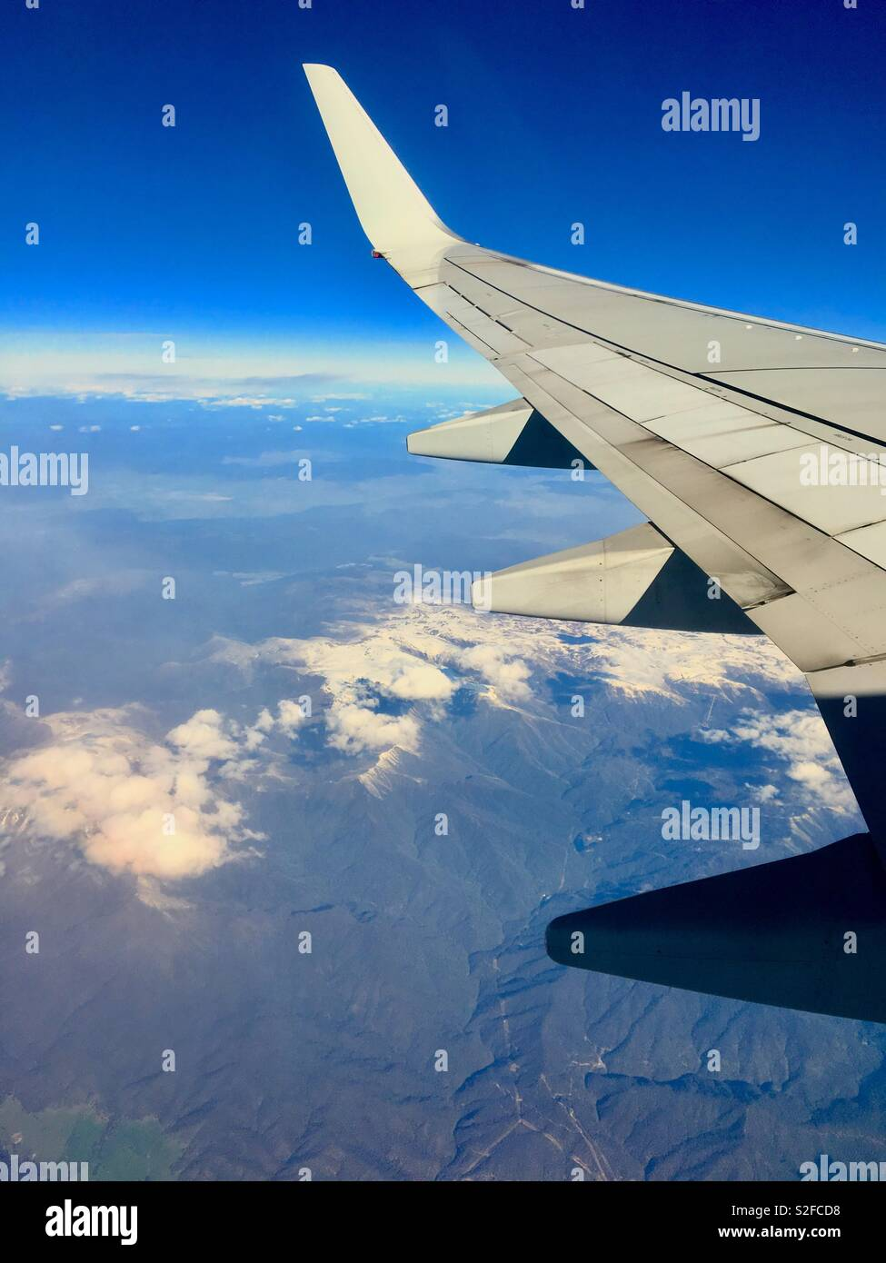 View of snowy mountains in Australia from aeroplane window - Stock Image