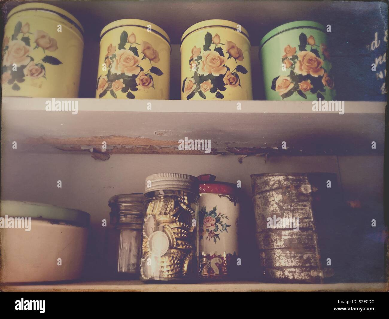 Old kitchen canisters - Stock Image