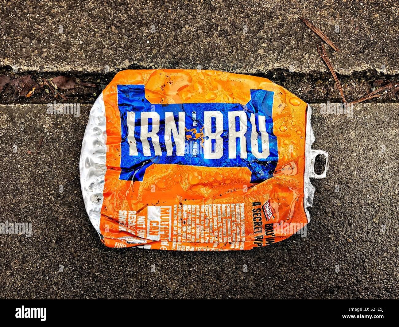 Flattened Irn Bru can. - Stock Image