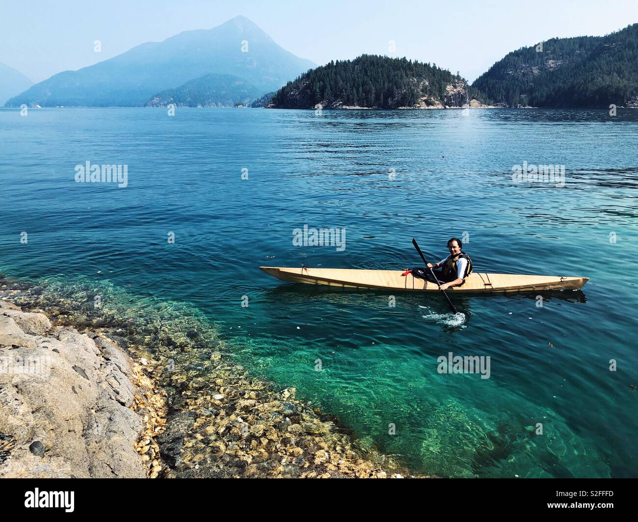 Happy kayaker in Desolation Sound - Stock Image
