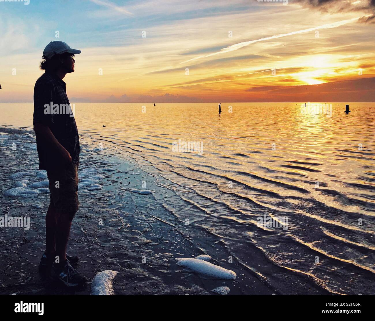 Sunset worshiper in Florida - Stock Image