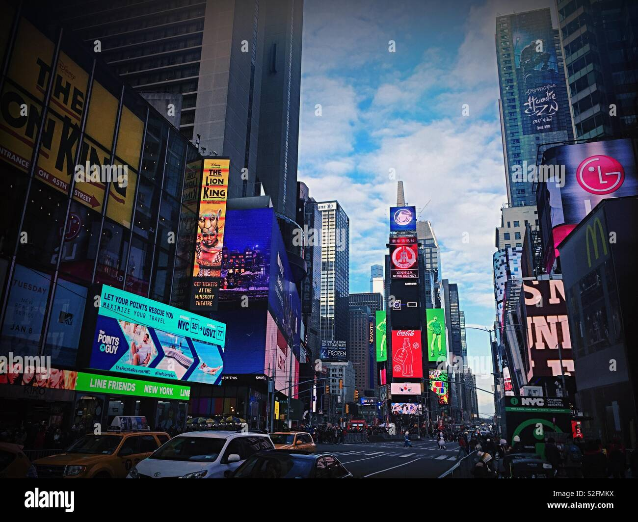 Automobile traffic and pedestrians in brightly lit Times Square, New York City, USA - Stock Image
