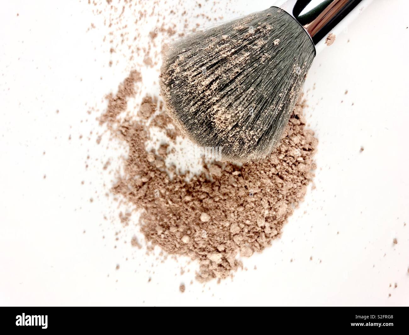 Powdered makeup and brush on white background - Stock Image