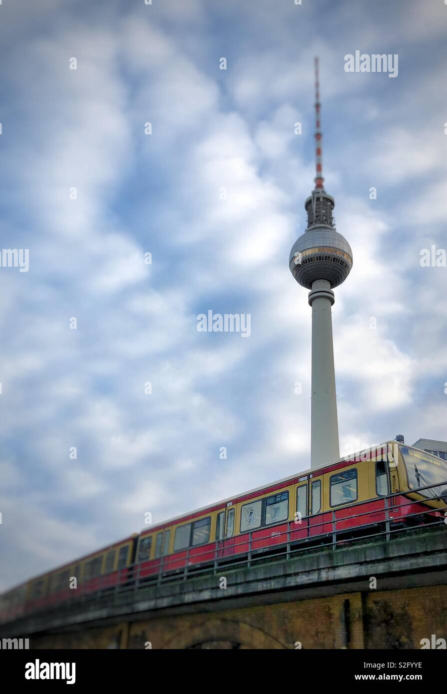S-Bahn train in city of Berlin with television tower Stock Photo