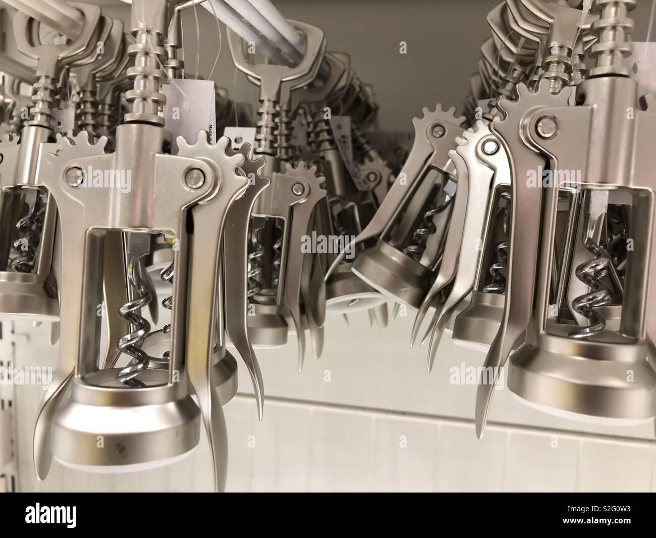 Corkscrew and bottle opener on display - Stock Image