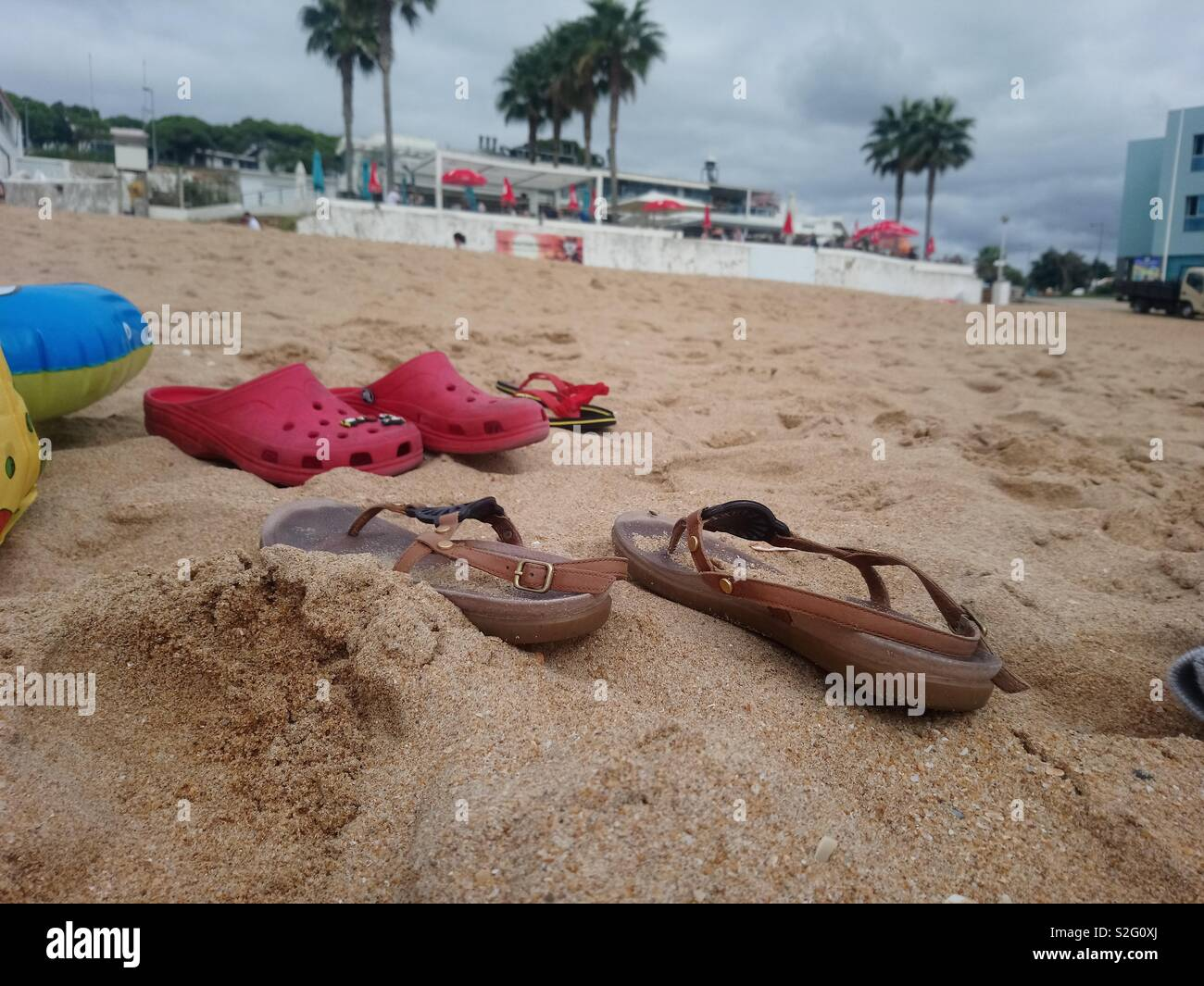 shoes on the beach - Stock Image