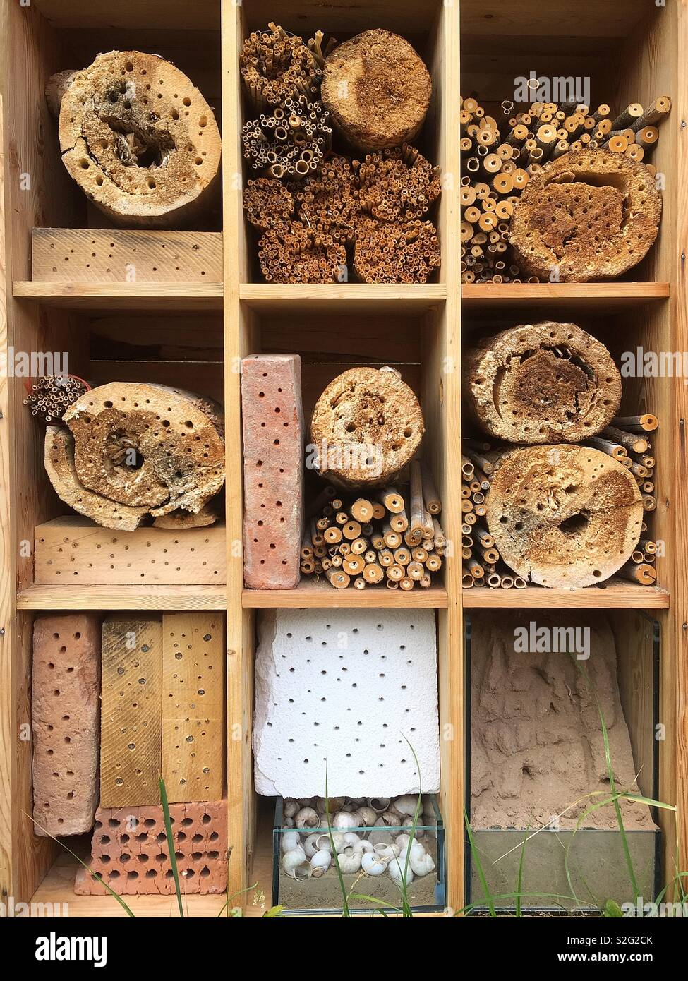 Environmentally friendly bee-house: a home made from natural and biodegradable materials designed to help arrest the decline in bee populations. - Stock Image