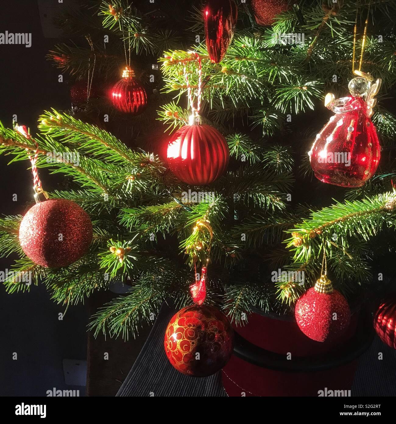 Christmas Baubles on a tree - Stock Image