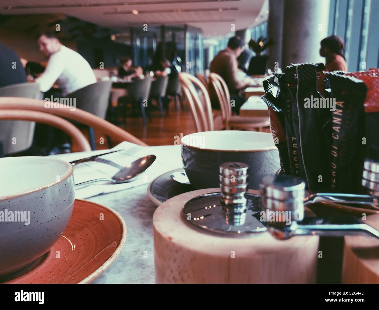 View from table of people sitting at buffet break tables in a typical UK hotel. - Stock Image