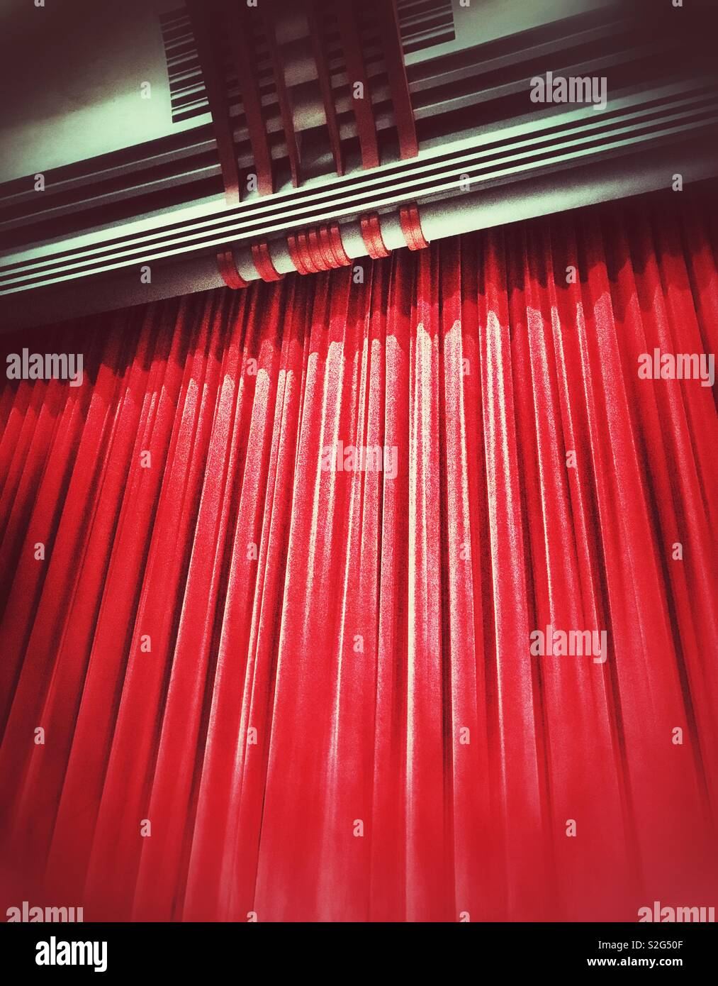 The red curtain at the end of a theatre show - Stock Image