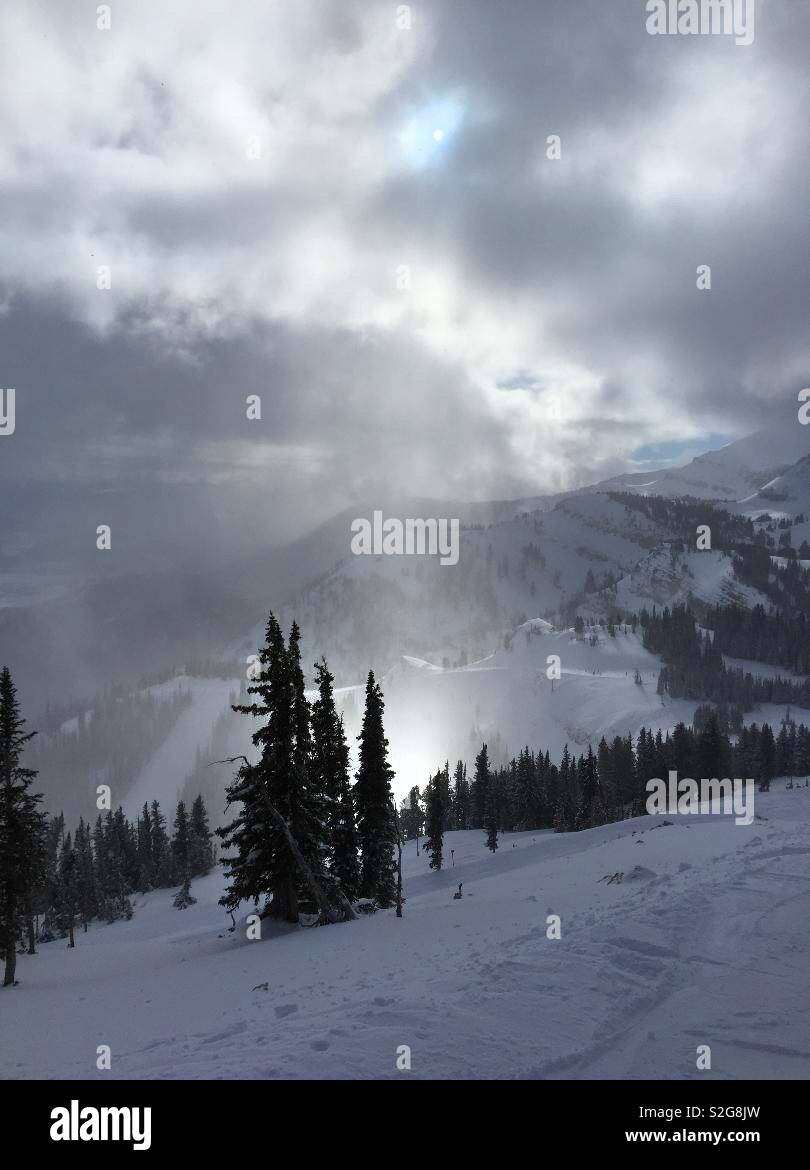 The hole in the cloud sends us a stream of sunlight down on the mountains - Stock Image