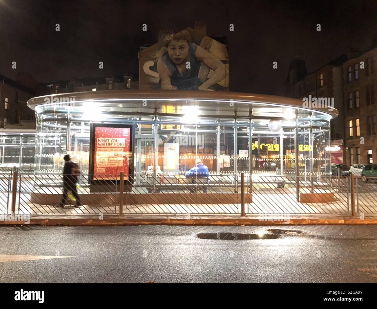 Bus stop, winter evening. Partick, Glasgow. Scotland. United Kingdom. - Stock Image